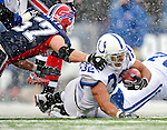 3 January 2010: Indianapolis Colts' running back Mike Hart (32) is tackled by Jon Corto (57) during a game against the Buffalo Bills on a cold, snowy, final game of the season at Ralph Wilson Stadium in Orchard Park, New York. The Bills defeated the Colts 30-7. Mandatory Credit: Ed Wolfstein Photo