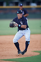 New York Yankees third baseman Kyle Gray (2) throws to first base during a Florida Instructional League game against the Pittsburgh Pirates on September 25, 2018 at Yankee Complex in Tampa, Florida.  (Mike Janes/Four Seam Images)