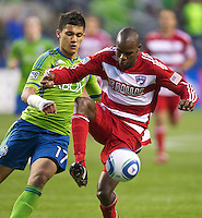 Dallas FC midfielder Jackson Goncalves, right, gets control of the ball in front of Seattle Sounders FC forward Fredy Montero chase down the ball during play at Qwest Field in Seattle Saturday May 14, 2011. Dallas won the game 1-0.