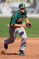 Siena Saints infielder Justin Esquerra (12) during a game against the Central Florida Knights at Jay Bergman Field on February 16, 2014 in Orlando, Florida.  UCF defeated Siena 9-6.  (Mike Janes/Four Seam Images)