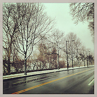 Snow falls on West River Drive on March 8, 2013.