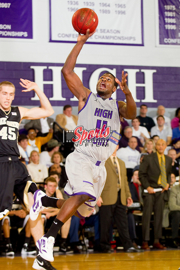Shay Sine #11 of the High Point Panthers drives to the basket during first half action against the Wake Forest Demon Deacons at Millis Athletic Center on December 7, 2011 in High Point, North Carolina.  The Demon Deacons defeated the Panthers 87-83.   (Brian Westerholt / Sports On Film)