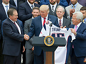 United States President Donald J. Trump, center, shakes hands with head coach Bill Belichick, left, as he and New England Patriots owner Robert Kraft, right, hold up the Super Bowl LI jersey as the President welcomes the Super Bowl Champions to the South Lawn of White House in Washington, DC on Wednesday, April 19, 2917.<br /> Credit: Ron Sachs / CNP<br /> (RESTRICTION: NO New York or New Jersey Newspapers or newspapers within a 75 mile radius of New York City)
