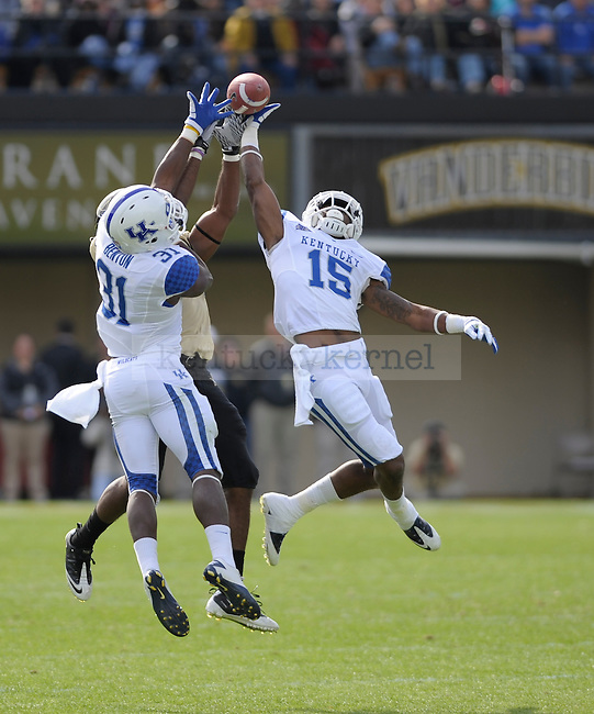 Kentucky Wildcats safety Martavius Neloms (15) and FS Mike Benton (31)  break up a pass during the University of Kentucky Football game against  Vanderbilt at Vanderbilt Stadium in Nashville, Tn., on 11/12/11. Uk trailed the game at half 0-24. Photo by Mike Weaver | Staff
