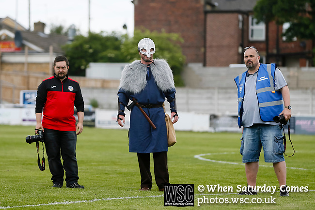Ragnar the Viking, Yorkshire's mascot with the photographers for the two teams. Yorkshire v Parishes of Jersey, CONIFA Heritage Cup, Ingfield Stadium, Ossett. Yorkshire's first competitive game. The Yorkshire International Football Association was formed in 2017 and accepted by CONIFA in 2018. Their first competative fixture saw them host Parishes of Jersey in the Heritage Cup at Ingfield stadium in Ossett. Yorkshire won 1-0 with a 93 minute goal in front of 521 people. Photo by Paul Thompson