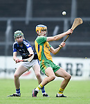 Aidan Mc Carthy of Inagh-Kilnamona in action against Tom O Rourke of Kilmaley during their Minor A county final at Cusack Park. Photograph by John Kelly.