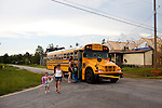 Amanda Porter and her daughter Krista Holbrooks, 5, walk to their temporary home after Krista gets home from school in Vaughn, Georgia August 12, 2011. In April, Vaughn was hit by a tornado that destroyed many homes in the area. Months later, the community is still picking up the pieces.