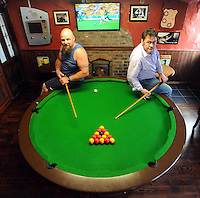 Pictured with the round pool table in O'Reilly's Bar, Kilgarvan, Co. Kerry, were  Ivan McCarthy, who designed and built the table,  and Gavin Malone. Picture: Eamonn Keogh (MacMonagle, Killarney)