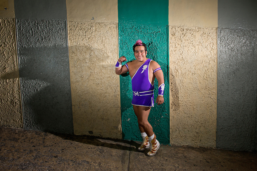 "Maximo a Lucha Libre wrestler, an ""Exotico"", meaning he fights as a gay Luchador poses in the hallway of Arena Mexico. Mexico City"