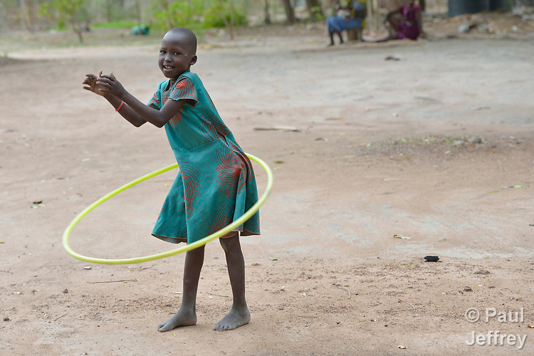 A girl uses a hula hoop in the Loreto Primary School in Rumbek, South Sudan. The Loreto Sisters began a secondary school for girls in 2008, with students from throughout the country, but soon after added a primary in response to local community demands.