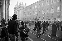 Rioters and scared tourists  in piazza San Giocanni during the urban guerilla triggered by violent fringes in piazza San Giovanni.  Rome, Italy. 15/10/2011