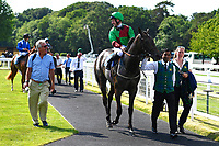 Winner of The Toby Balding Memorial Novice Stakes (Plus 10),Nyaleti ridden by John Egan and trained by Mark Johnston  are led into the winners enclosure during Father's Day Racing at Salisbury Racecourse on 18th June 2017