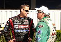 Nov 14, 2010; Pomona, CA, USA; NHRA funny car driver Bob Tasca III (left) talks with John Force during the Auto Club Finals at Auto Club Raceway at Pomona. Mandatory Credit: Mark J. Rebilas-