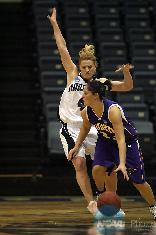27 MAR 2009:  Guard Lauren Barber (23) of Minnesota State University- Mankato dribbles around guard Jennifer Leedham (4) of Franklin Pierce defender during the Division II Women's Basketball Championship held at the Bill Greehey Arena on the St. Mary's University campus in San Antonio, Tx.  MSU-Mankato defeated Franklin Pierce 103-94 to win the national title game.  Rodolfo Gonzalez/NCAA Photos