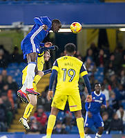 Kurt Zouma of Chelsea beats Dan Crowley of Oxford United in the air during the The Checkatrade Trophy match between Chelsea U23 and Oxford United at Stamford Bridge, London, England on 8 November 2016. Photo by Andy Rowland.
