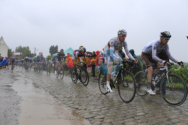 Riders including World Champion Rui Costa (POR) Lampre-Merida tackle the1st cobbled sector 9 from Gruson to Crossroads de l'Arbe during Stage 5 of the 2014 Tour de France running 155.5km from Ypres to Arenberg. 9th July 2014.<br /> Picture: Eoin Clarke www.newsfile.ie