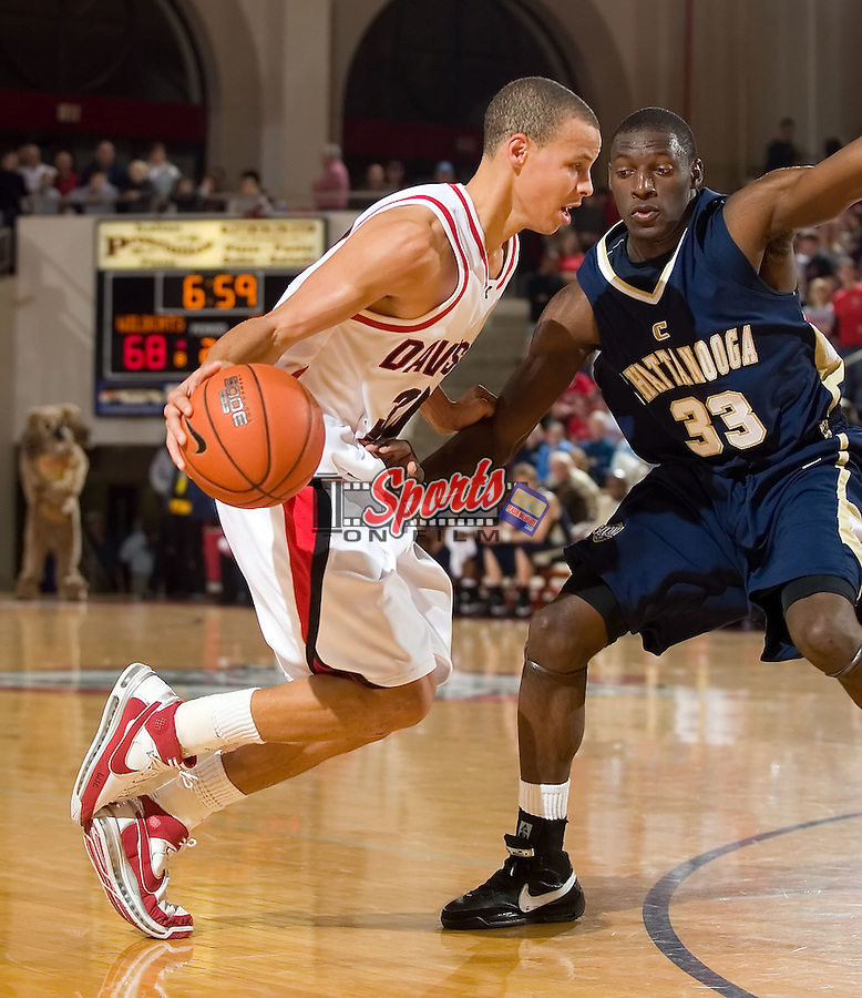 Davidson guard Stephen Curry (30) is defended by Chattanooga forward Kevin Goffney (33) during second half action at the John M. Belk Arena Saturday, January 19, 2008 in Davidson, NC.  The Wildcats defeated the Mocs 85-58.