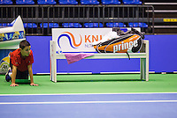 Rotterdam, Netherlands, December 17, 2015,  Topsport Centrum, Lotto NK Tennis, Bench with racket bag and ballboy<br /> Photo: Tennisimages/Henk Koster