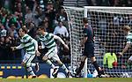 Erik Sviatchenko celebrayes pulling a goal back for Celtic
