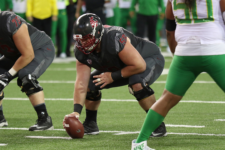 Riley Sorenson (58), Washington State center, awaits the snap count during the Cougars Pac-12 Conference game against the Oregon Ducks on October 1, 2016.   The Cougs defeated the Ducks at Martin Stadium, 51-33.