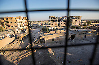 August 2017. YPG Media Centre, Raqqa, Syria.<br /> A general view of Al-Nahda neighbourhood, an area on the front lines of Raqqa which are controlled by the MFS and YPG forces.<br /> The MFS (Syriac Military Council) are a group of Assyrian Christians who fight alongside the Syrian Democratic Forces in the fight to topple ISIS.<br /> Photographer: Rick Findler