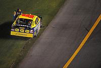 Jul. 5, 2008; Daytona Beach, FL, USA; NASCAR Sprint Cup Series driver Elliott Sadler climbs from his car after hitting the wall during the Coke Zero 400 at Daytona International Speedway. Mandatory Credit: Mark J. Rebilas-