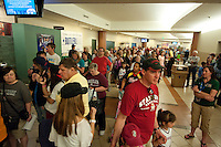 DENVER, CO--Stanford fans line the main concourse as the Cardinal sign posters during a fan autograph session at the Pepsi Center for the 2012 NCAA Women's Final Four festivities in Denver, CO.