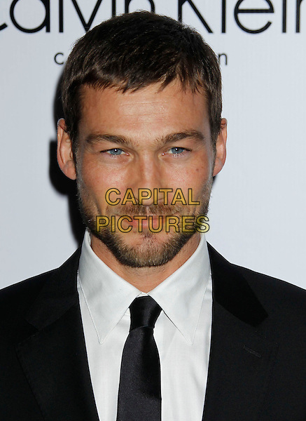 ANDY WHITFIELD.Attending Calvin Klein Collection and LOS ANGELES NOMADIC DIVISION present a celebration of L.A. Arts Month held at the Calvin Klein Store, Los Angeles, CA, USA, 28th January 2010..portrait headshot beard facial hair black suit tie white shirt .CAP/ADM/MJ.©Michael Jade/Admedia/Capital Pictures