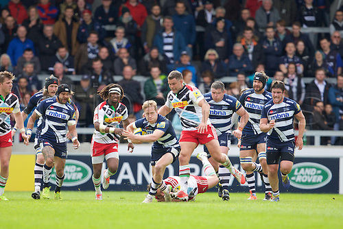 25.04.2015.  Sale, England.  Aviva Premiership Rugby. Sale Sharks versus Harlequins. Sale Sharks fullback Mike Haley aviods Harlequins number 8 Nick Easter.