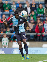Anthony Stewart of Wycombe Wanderers heads clear during the Sky Bet League 2 match between Wycombe Wanderers and Barnet at Adams Park, High Wycombe, England on 16 April 2016. Photo by Andy Rowland.