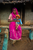 18 month old Prahlad RAMESH, a recovering malnourished boy is seen with his grandmother, Baijabari BADRI outside their house in Dhawati VIllage of Khaknar block of Burhanpur district in Madhya Pradesh, India.  Photo: Sanjit Das/Panos for ACF