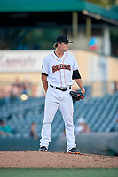 Jupiter Hammerheads relief pitcher Steven Farnworth (23) looks in for the sign during a game against the Palm Beach Cardinals on August 4, 2018 at Roger Dean Chevrolet Stadium in Jupiter, Florida.  Palm Beach defeated Jupiter 7-6.  (Mike Janes/Four Seam Images)