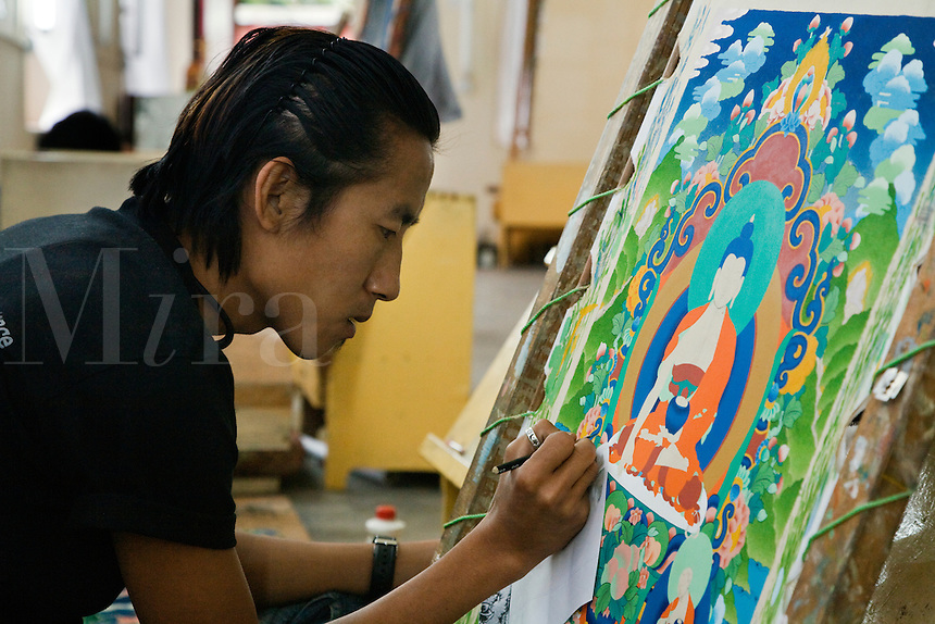 A THANKA PAINTER learns his craft at the NORBULINGKA INSTITUTE, a TIBETAN BUDDHIST CULTURAL CENTER - DHARMSALA, INDIA