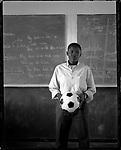 Aretha Tshabalala (20), in shcool,  Kwa-xuma Township, Soweto, South Africa, 1998