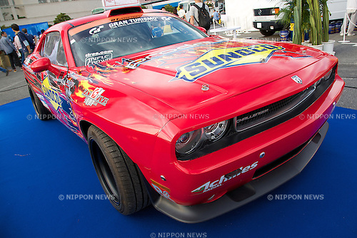 """An exhibition car """"Dodge Challenger"""" at the Tokyo Motor Fes 2014 on October 11th in Odaiba, Tokyo, Japan. The Tokyo Motor Fes 2014 runs from October 11th to 13th with the aim of giving visitors of all ages a chance to interact with current and futuristic motorized vehicles. Held outside on reclaimed land in Tokyo Bay the event has enough space for visitors to test new vehicles and for a synchronized driving demonstration by the Cirque de Mobi. This year Mercedes-Benz and BMW will also participate along with 13 Japanese makers. (Photo by Rodrigo Reyes Marin/AFLO)"""