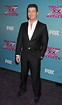 LOS ANGELES, CA - DECEMBER 20: Simon Cowell attends the FOX's 'The X Factor' Season Finale - Night 2 at CBS Televison City on December 20, 2012 in Los Angeles, California.