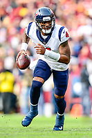 Landover, MD - November 18, 2018: Houston Texans quarterback Deshaun Watson (4) escapes the pocket during first half action of game between the Houston Texans and the Washington Redskins at FedEx Field in Landover, MD. (Photo by Phillip Peters/Media Images International)
