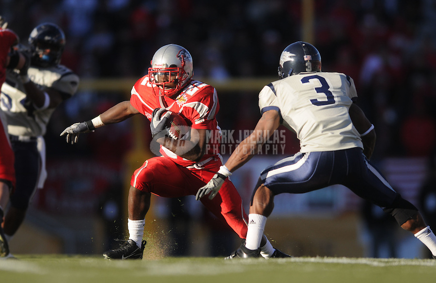 Dec 22, 2007; Albuquerque, NM, USA; New Mexico Lobos running back Paul Baker (22) runs the ball against the Nevada Wolf Pack in the New Mexico Bowl at University Stadium. Mandatory Credit: Mark J. Rebilas-US PRESSWIRE