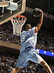 """13 October 2006: UNC's Alex Stepheson makes a reverse slam dunk. The University of North Carolina at Chapel Hill Tarheels held their first Men's and Women's basketball practices of the season as part of """"Late Night with Roy Williams"""" at the Dean E. Smith Center in Chapel Hill, North Carolina."""