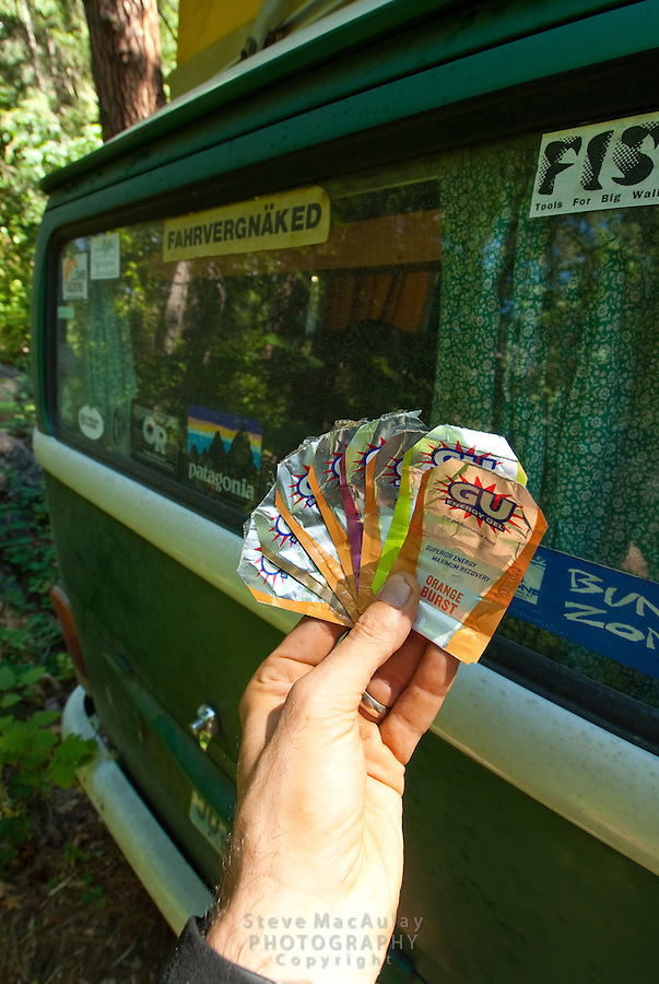 Gu Energy Gel packets fanned out in hikers hand, Icicle Creek, leavenworth, WA.