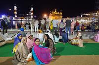 Asia,India,Punjab, Amristar, Golden temple,Palki Sahib where is the Sikh holy book, pilgrims family spend the night praing
