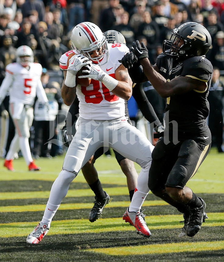 Ohio State Buckeyes wide receiver Chris Fields (80) catches a touchdown pass against Purdue Boilermakers defensive back Anthony Brown (9) during the second quarter of the NCAA football game at Ross-Ade Stadium in West Lafayette, IN on Saturday, November 2, 2013. (Columbus Dispatch photo by Jonathan Quilter)