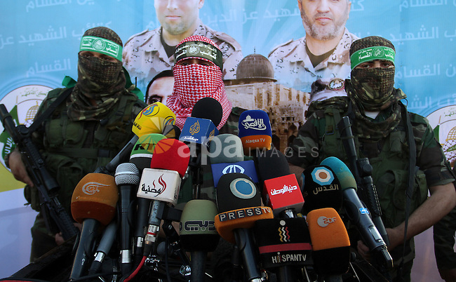 Spokesman of al-Qassam Brigades, the military wing of Hamas movement, Abu Obeida speaks during an anti-Israel military parade staged by members of al-Qassam Brigades, the armed wing of the Hamas movement, in Rafah in the southern Gaza Strip August 21, 2016. Photo by Abed Rahim Khatib