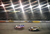 May 1, 2009; Richmond, VA, USA; (Editors Note: Special effects filter used in creation of this image) NASCAR Nationwide Series driver Kyle Busch (18) leads Carl Edwards (60) through turn one during the Lipton Tea 250 at the Richmond International Raceway. Mandatory Credit: Mark J. Rebilas-