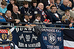 Home fans in the Bobby Cox Stand watching the action during a Scottish League First Division match at Dens Park stadium against visitors Greenock Morton. The visitors won by one goal to nil watched by a crowd of 4,096. Dundee  stadium was situated on the same street as their city rival Dundee United, whose Tannadice Park ground was situated a few hundred yards away.