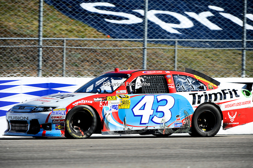September 23, 2012 Sprint Cup Series driver Aric Almirola (43)  at the NASCAR Sprint Cup Series Sylvania 300 race held at the New Hampshire Motor Speedway in Loudon, New Hampshire.  Eric Canha/CSM