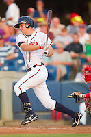 Joe Leonard #39 of the Rome Braves follows through on his swing against the Greenville Drive at State Mutual Stadium July 24, 2010, in Rome, Georgia.  Photo by Brian Westerholt / Four Seam Images