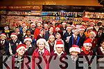 Children from Holy Family NS Carol Singing in Garveys Supervalu on Friday.