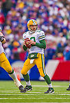 14 December 2014: Green Bay Packers quarterback Aaron Rodgers looks for an open receiver in the first quarter against the Buffalo Bills at Ralph Wilson Stadium in Orchard Park, NY. The Bills defeated the Packers 21-13, snapping the Packers' 5-game winning streak and keeping the Bills' 2014 playoff hopes alive. Mandatory Credit: Ed Wolfstein Photo *** RAW (NEF) Image File Available ***