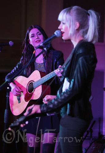 11 APR 2015 - STOWMARKET, GBR - Rebecca Lovell (left) of Larkin Poe watches her sister Megan Lovell (right) during their gig at the John Peel Centre for Creative Arts in Stowmarket, Great Britain (PHOTO COPYRIGHT © 2015 NIGEL FARROW, ALL RIGHTS RESERVED)